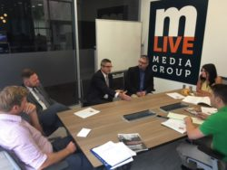 The League's Anthony Minghine meets with mlive.com officials in Jackson Monday morning along with Jackson City Council member and MML Board Member Dan Greer (right).